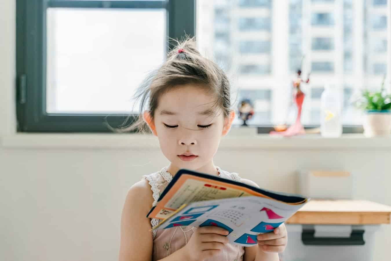 girl loving reading book
